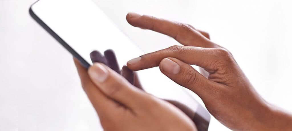 NuData Security: Hand touching mobile device